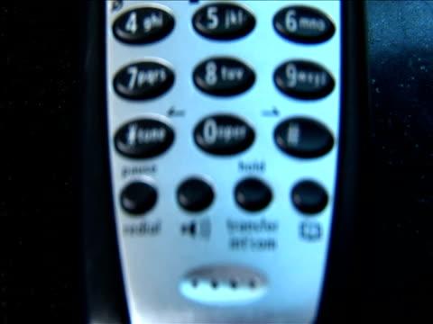 ecu, focusing, pan, telephone - schnurloses telefon stock-videos und b-roll-filmmaterial