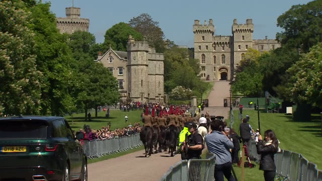 telephoto shot of the wedding procession travelling down the 'long walk' towards windsor castle during the rehearsal for the wedding of prince harry... - meghan harry stock videos and b-roll footage