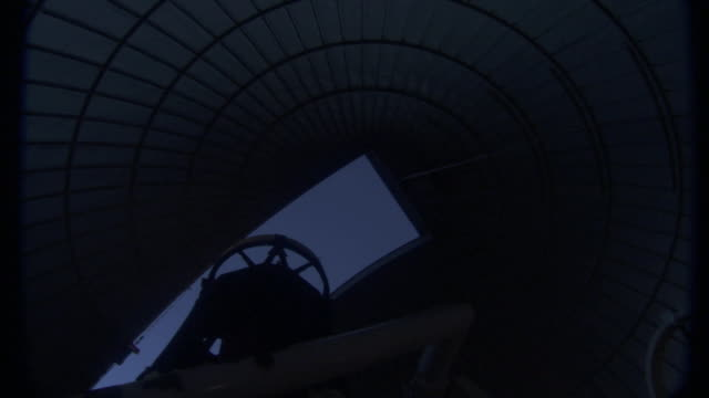 a telescope moves toward an observatory opening. - osservatorio video stock e b–roll