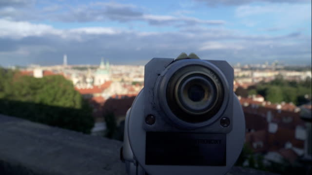 telescope on the view point to see old prague city including many orange building with orange roof - eastern european culture stock videos & royalty-free footage