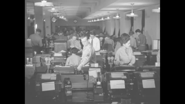 cu teletype machine / cu pan teletype machines / teletype operations room with army men and women manning machines / row of teletypewriters soldiers... - repetition stock videos & royalty-free footage
