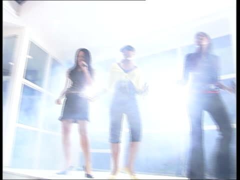 New multimedia strategies Camera crew PAN advertising pop group on stage