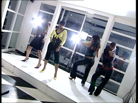 vídeos de stock, filmes e b-roll de new multimedia strategies england london four black females dancing on stage to music in a group created by advertising agency man at side of stage... - lisa i'anson