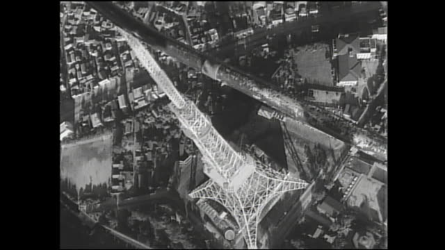 a television and communication antenna is positioned above the tokyo tower. - showa period stock videos & royalty-free footage