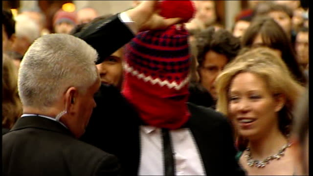 television awards 2008: celebrity red carpet arrivals; simon amstell arriving / unidentified man with head covered by stripy balaclava, then taking... - 英国アカデミー賞テレビ部門点の映像素材/bロール