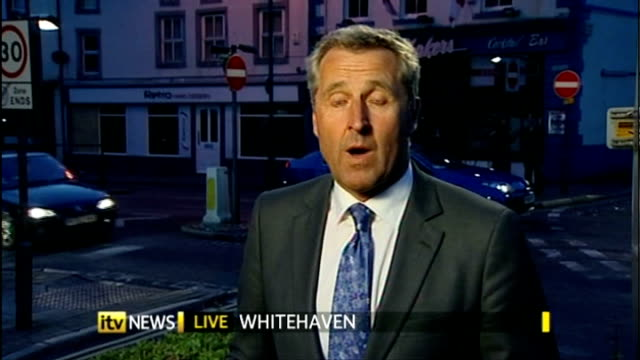 Whitehaven EXT / NIGHT ITV News presenter Mark Austin introduces ITV News programme on occasion of Cumbria shootings