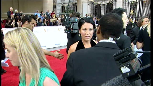 red carpet arrivals england london ext patricia brooker speaking to reporter / jessie wallace speaking to reporter / brooker speaking to reporter sot... - eastenders stock-videos und b-roll-filmmaterial
