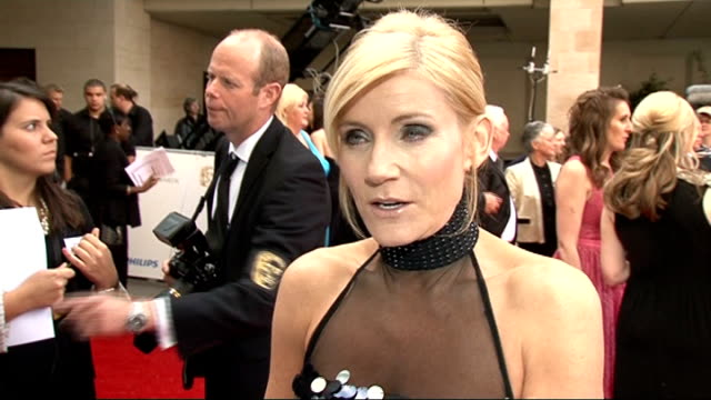 red carpet arrivals michelle collins interview sot on her dress / on switching to coronation street from eastenders / on the bafta nominations back... - reality tv stock videos & royalty-free footage