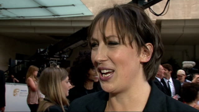 red carpet arrivals miranda hart interview sot on being excited to be nominated for a bafta / on not knowing anything about the only way is essex /... - reality fernsehen stock-videos und b-roll-filmmaterial