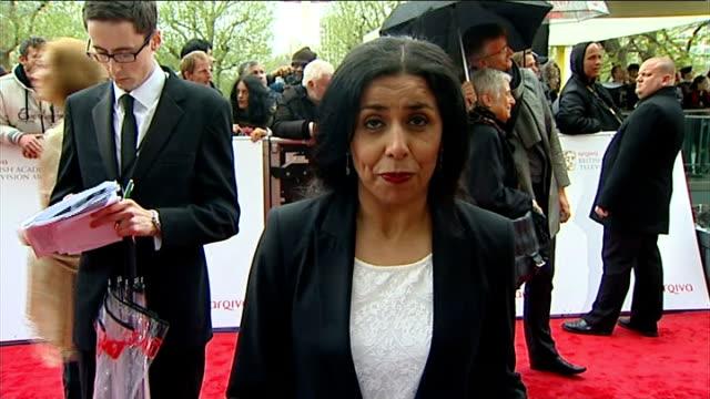 television awards 2013; royal festival hall: reporter to camera cutaway reporter chatting to michael palin - マイケル パリン点の映像素材/bロール