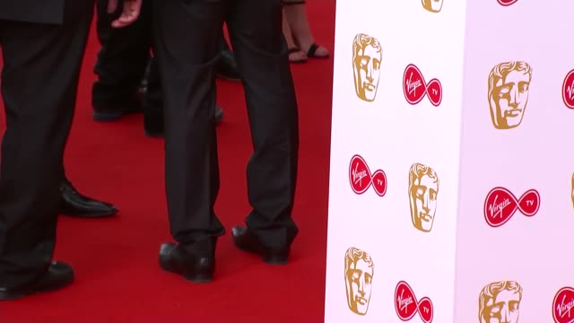 television awards 2018: red carpet photocalls; england: london: southbank centre: lucy mecklenburgh on red carpet / daniel lawrence taylor and woman... - 英国アカデミー賞テレビ部門点の映像素材/bロール