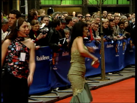 nina nannar england london helen worth towards side kacey ainsworth on red carpet side kenneth branagh on red carpet kevin kennedy posing for photos... - wrap dress stock videos and b-roll footage