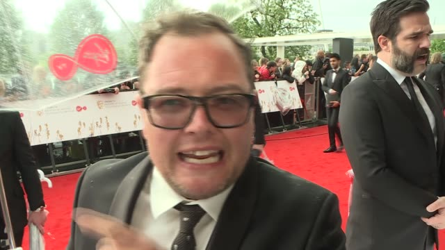 red carpet arrivals and interviews Alan Carr interview SOT Alan Carr spins round with umbrella on red carpet / Rob Delaney on red carpet GVs Matt...