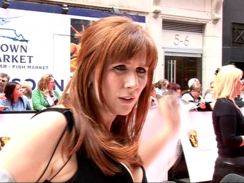Red carpet arrivals and interviews Fans waiting / back view of Catherine Tate signing autographs / Catherine Tate interview on red carpet SOT On how...