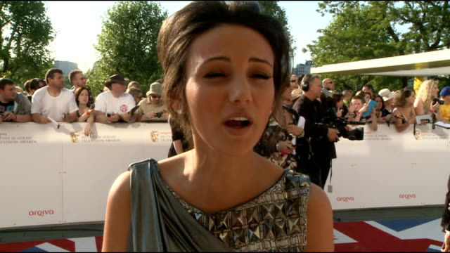 red carpet arrivals Michelle Keegan interview SOT / brief shot Melissa George / Childs posing with fan / Stephen Mangan interview SOT / Holly...