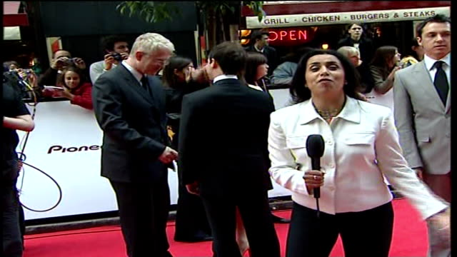 vidéos et rushes de television awards; reporter to camera as richard curtis seen chatting in background curtis along through press with emma freud - emma freud