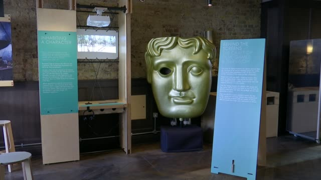 opens its doors for first time with new costume exhibition; england: london: piccadilly: british academy of film and television arts : ext general... - bafta mask stock videos & royalty-free footage