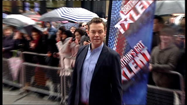 britain's got talent auditions in manchester; various of stephen mulhern posing for photographers on red carpet as arriving at auditions/ various of... - britain's got talent stock-videos und b-roll-filmmaterial