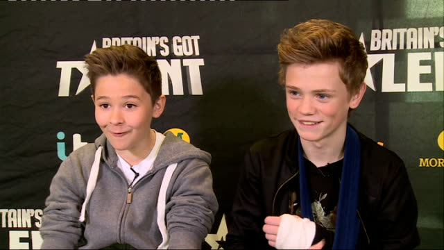 'britain's got talent': bars and melody interview; england: london: int leondre devries and charlie leneham interview sot - britain's got talent stock-videos und b-roll-filmmaterial