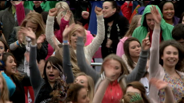 britain's got talent flash mob in trafalgar square; general views of large crowd dancing to 'queen' 'don't stop me now' / close up of dancers in... - britain's got talent stock-videos und b-roll-filmmaterial