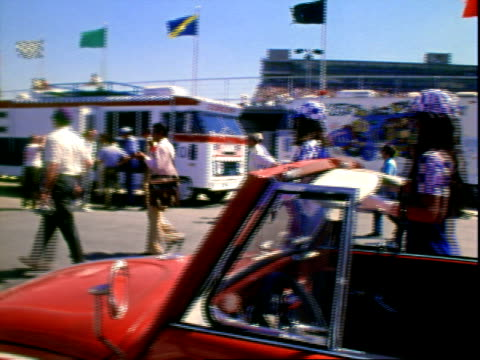 television broadcaster and motor sports enthusiast hugh downs wearing white racing suit dark sunglasses while standing in pits of ontario motor... - stephen  boyd stock videos & royalty-free footage