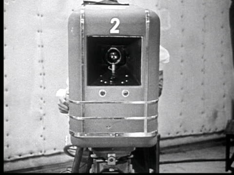 1945 b/w montage television camera front. back of camera dissolve into inside showing electronic parts. man holds iconoscope camera tube / usa / audio - 1945 stock videos & royalty-free footage