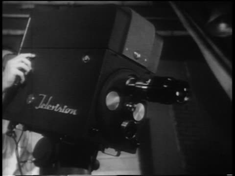 b/w 1952 television camera with cameraman behind it turning toward + pointing straight at camera - television studio stock videos & royalty-free footage
