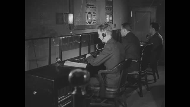 vidéos et rushes de television cameras / man pushes one camera to line up with the small window on wall / men working inside control room / note: exact year not known;... - nbcuniversal