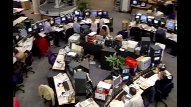 int bbc staff at desks in bbc newsroom bbc workers demonstrating against proposed cuts outside bush house - bbc video stock e b–roll