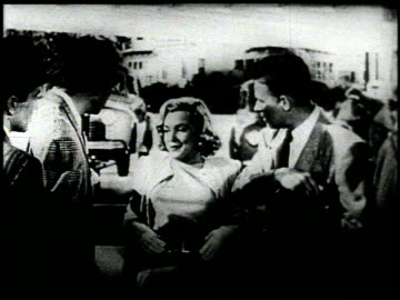 """television commercial featuring marilyn monroe flanked by threemen in suits and a gas station attendant, she says in a breathy voice, """"this is the... - television advertisement stock videos & royalty-free footage"""