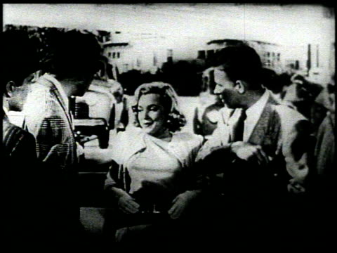 stockvideo's en b-roll-footage met television commercial featuring marilyn monroe flanked by threemen in suits and a gas station attendant she says in a breathy voice this is the first... - marilyn monroe