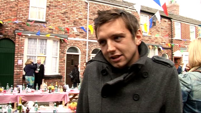 coronation street 50th anniversary party gvs and interviews craig gazey interview sot on the party / 50th anniversary cast don't know much about... - ソープオペラ点の映像素材/bロール
