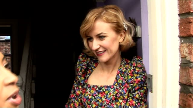 coronation street 50th anniversary party gvs and interviews katherine kelly interview with reporter partly in shot sot on the party / her character... - ソープオペラ点の映像素材/bロール