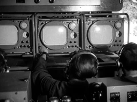 television crew sits in broadcast truck in preparation for the bbc broadcast of the london 1948 olympic games - bbc stock videos & royalty-free footage