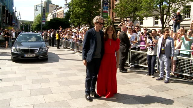 doctor who series 8 premiere: red carpet interviews; car along / peter capaldi and jenna coleman getting out of cars and along and posing for... - doctor who stock videos & royalty-free footage