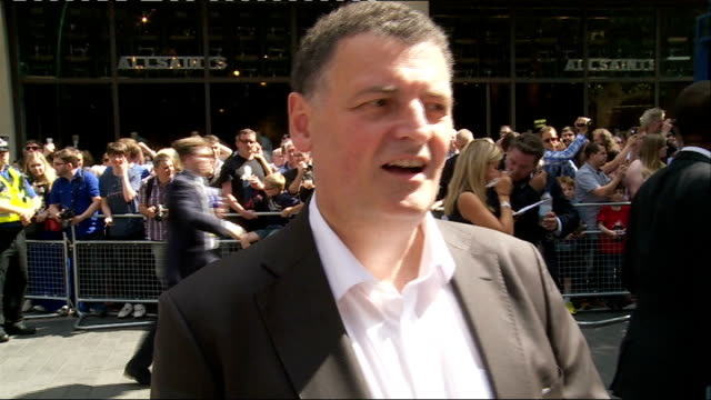 doctor who series 8 premiere red carpet interviews people waiting in crowd steven moffatt interview sot capaldi signing autographs for people in crowd - doctor who stock videos & royalty-free footage