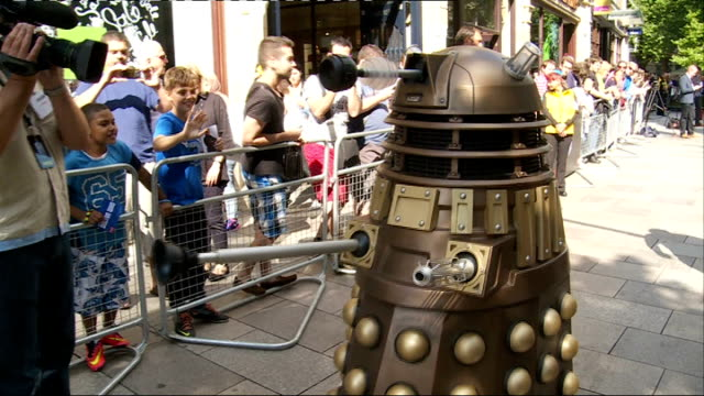doctor who series 8 premiere: red carpet interviews; wales: cardiff: st davids hall: ext people waiting behind barriers as person in cyberman costume... - doctor who stock videos & royalty-free footage