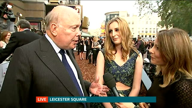 'downton abbey' series 5 premiere carmichael and fellowes live interview on red carpet with reporter in shot sot - premiere stock videos & royalty-free footage