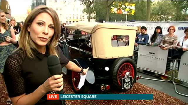 'downton abbey' series 5 premiere; england: london: leicester square: ext laura carmichael and julian fellowes live interview on red carpet with... - julian fellowes stock videos & royalty-free footage
