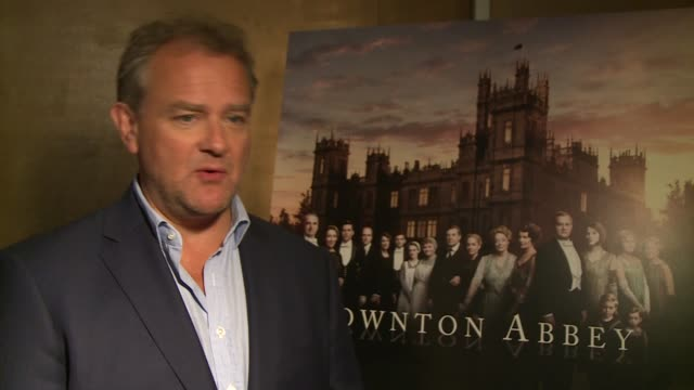 downton abbey series 6 launch hugh bonneville interview sot / rob jamescollier and michael fox interview sot - abbey monastery stock videos & royalty-free footage