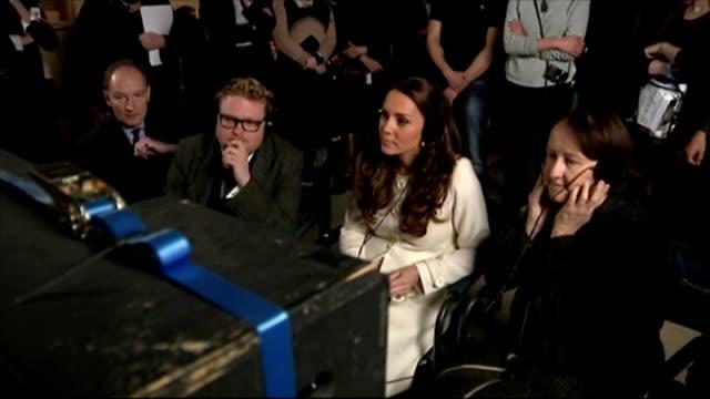 Duchess of Cambridge visits 'Downton Abbey' set Duchess of Cambridge seated with other on Downton set watching playback on tv screen