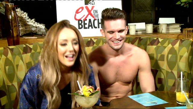 stockvideo's en b-roll-footage met 'ex on the beach' / 'geordie shore' intvs; england: int gary 'gaz' beadle and charlotte crosby interview sot - on how crazy 'ex on the ebach' series... - television game show