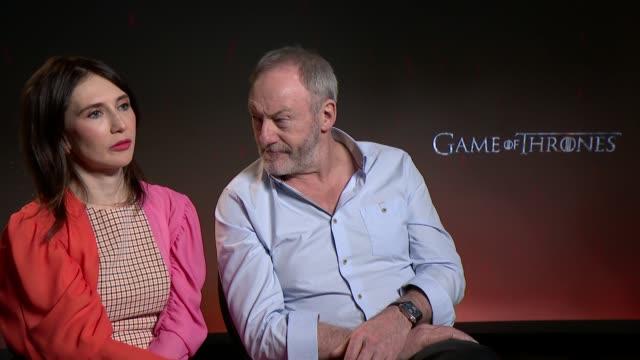 game of thrones junket interviews england london int carice van houten liam cunningham interview sot - liam cunningham stock videos & royalty-free footage