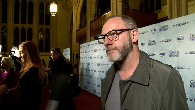'game of thrones' season 4 london premiere cunningham as interviewed by press sot / actress sophie turner on red carpet / liam cunningham interview... - liam cunningham stock videos & royalty-free footage