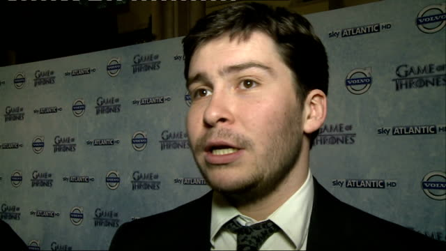 'game of thrones' season 4 london premiere england london int 'game of thrones' backdrop / daniel portman interview sot / portman being interviewed... - season 4 stock videos and b-roll footage