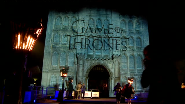 'Game of Thrones' season 4 London premiere EXT/NIGHT 'Game of Thrones' superimposed on exterior of Guildhall building