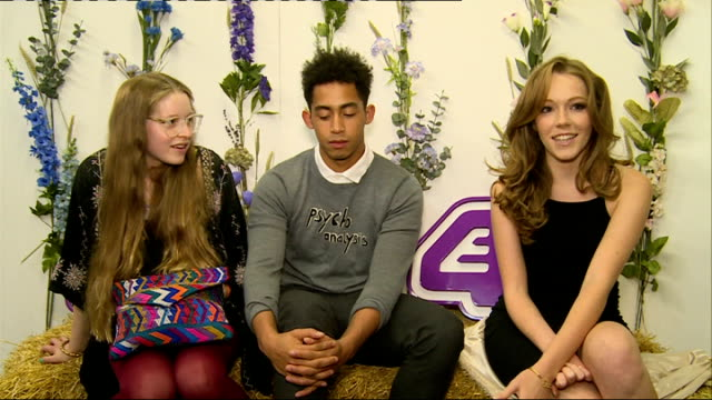 'glue' cast interview england london int jessie cave jordan stephens and charlotte spencer interview sot / cave stephens and spencer posing with... - cast member stock videos and b-roll footage