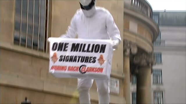 jeremy clarkson 'rant' as he awaits decision from bbc over 'fracas' incident new broadcasting house ext man dressed as 'the stig' along on large... - jeremy clarkson stock videos & royalty-free footage