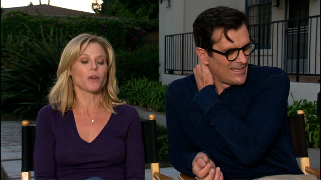 'modern family' cast interviews julie bowen and ty burrell interview sot - ty burrell stock videos and b-roll footage