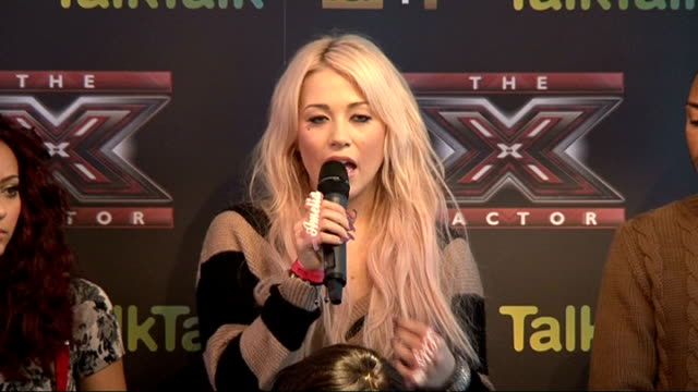 judges and contestants press conference ahead of x-factor final; amelia lily press conference sot - on the hmv single leak - it's a mistake, not a... - judge entertainment stock videos & royalty-free footage
